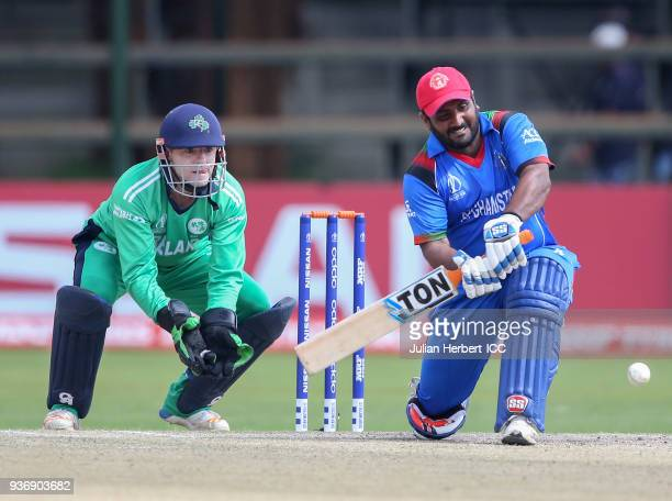 Nial O'Brien of Ireland looks on as Muhammed Shahzad of Afghanistan scores runs during The ICC Cricket World Cup Qualifier between Ireland and...