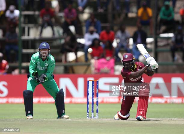 Nial O'Brien of Ireland looks on as Rovman Powell of The West Indies scores runs during The ICC Cricket World Cup Qualifier between The West Indies...