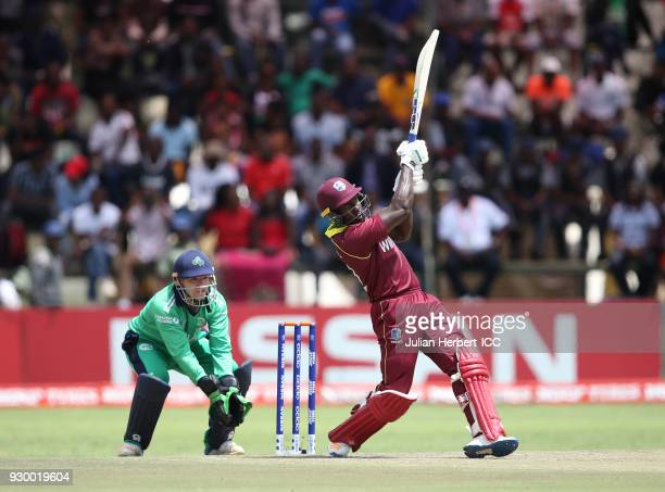 Nial O'Brien of Ireland looks on as Rovman Powell of The West Indies hits out during The ICC Cricket World Cup Qualifier between The West Indies and...