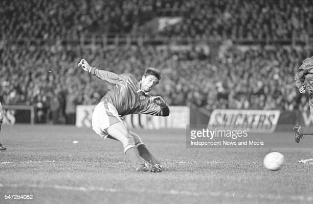 Nial Quinn shoots towards the England goal, an incident from the game at Landsdowne Road. Following the Irish goal a riot erupted and the game was...