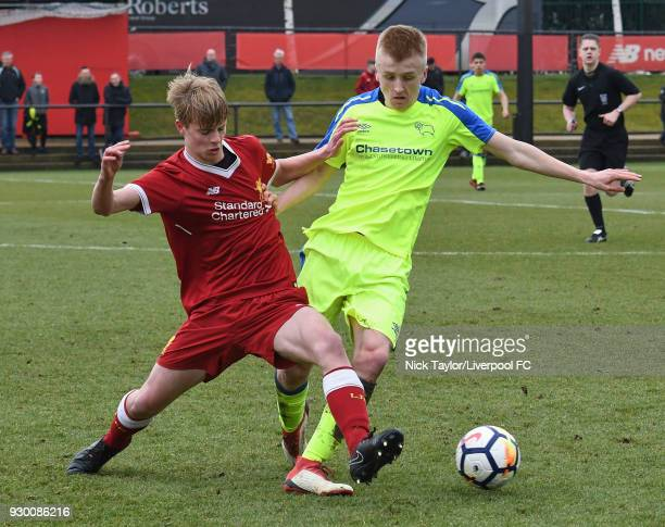 Niall Brookwell of Liverpool and Louie Sibley of Derby County in action during the U18 Premier League match between Liverpool and Derby County at The...