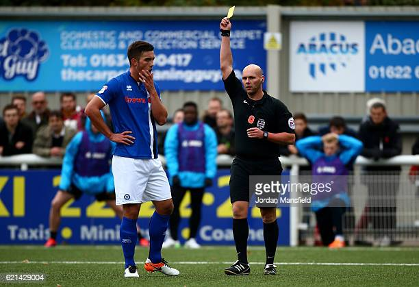 Niall Canavan of Rochdale is shown a yellow card for a challenge on Jamar Loza of Rochdale during the Emirates FA Cup First Round match between...