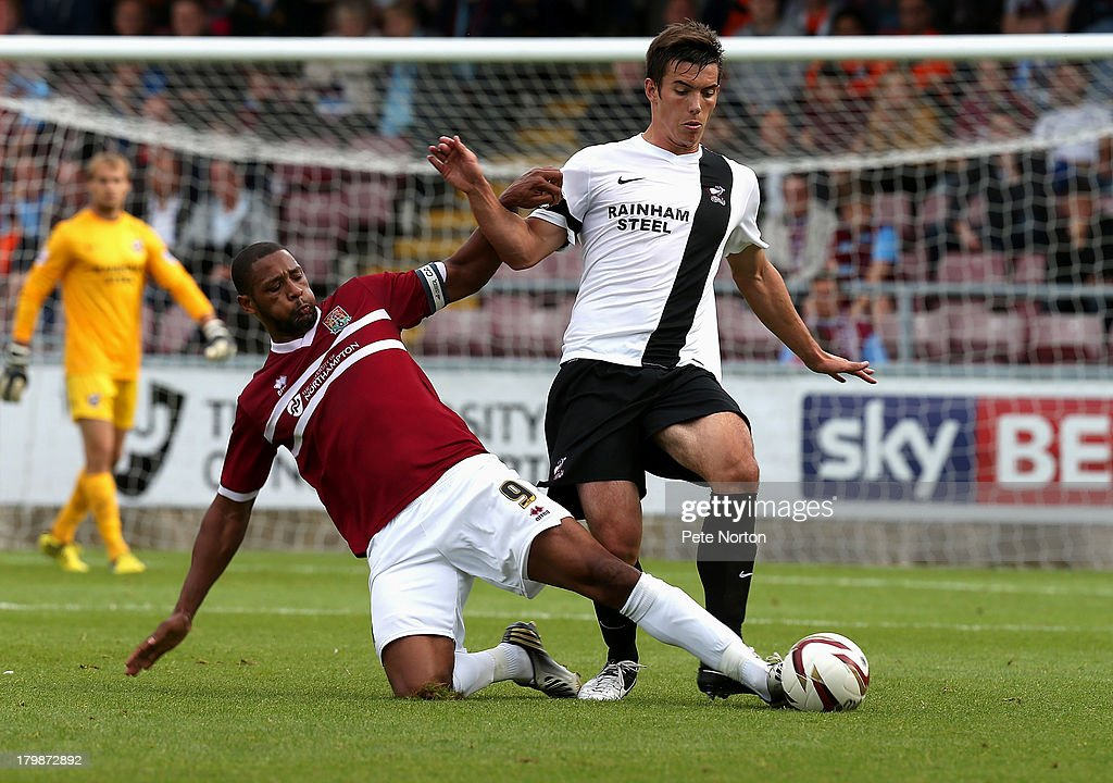 Niall Canavan of Scunthopre United contests the ball with Clive Platt of Northampton Town during the Sky Bet League Two match between Northampton Town and Scunthorpe United at Sixfields Stadium on September 7, 2013 in Northampton, England.