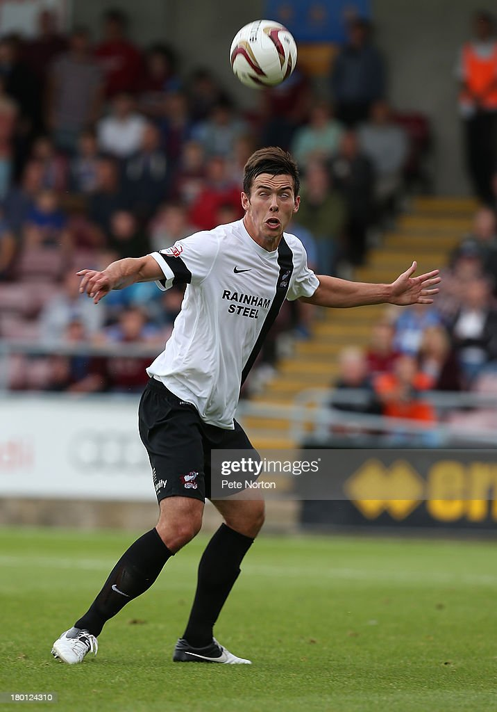 Niall Canavan of Scunthorpe United in action during the Sky Bet League Two match between Northampton Town and Scunthorpe United at Sixfields Stadium on September 7, 2013 in Northampton, England.