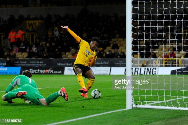 Niall Ennis of Wolverhampton Wanderers scores his team's first goal during the Premier League 2 match between Wolverhampton Wanderers U23 and...