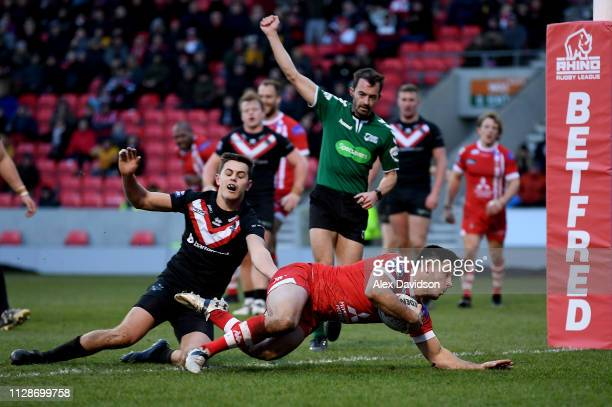 Niall Evalds of Salford Red Devils scores his sides third try during the Betfred Super League match between Salford Red Devils and London Broncos at...
