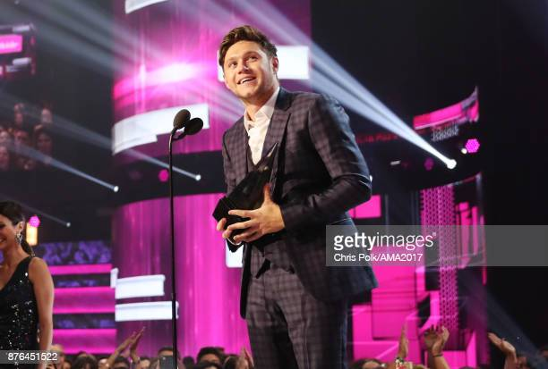 Niall Horan accepts New Artist of the Year presented by TMobile award onstage during the 2017 American Music Awards at Microsoft Theater on November...