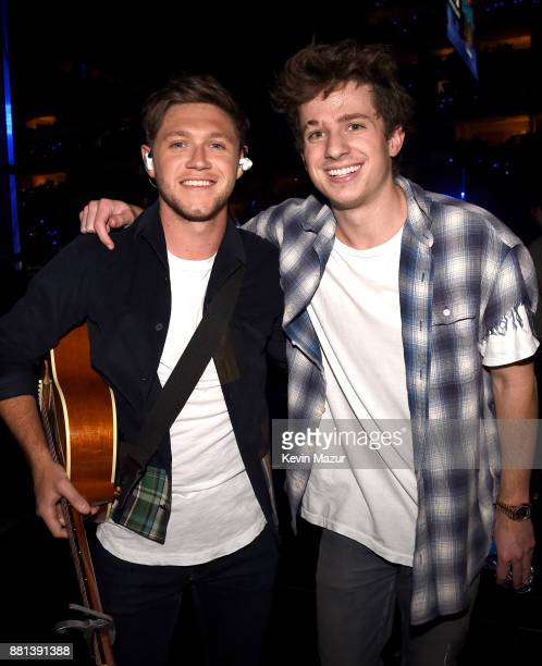 Niall Horan and Charlie Puth are seen backstage at 1061 KISS FM's Jingle Ball 2017 Presented by Capital One at American Airlines Center on November...