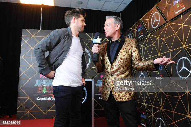 Niall Horan and Elvis Duran attend the Z100's Jingle Ball 2017 backstage on December 8 2017 in New York City