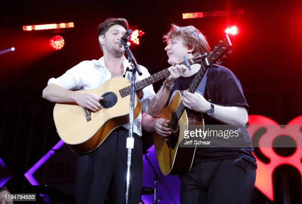Niall Horan and Lewis Capaldi perform during 1035 KISS FM's Jingle Ball 2019 Show on December 18 2019 in Chicago Illinois