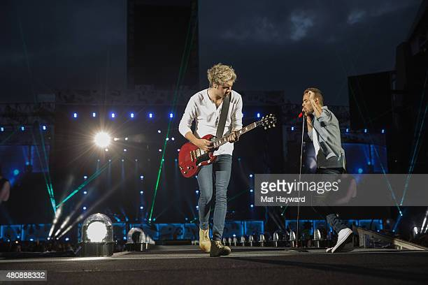 Niall Horan and Liam Payne of One Direction perform on stage at Century Link Field on July 15 2015 in Seattle Washington
