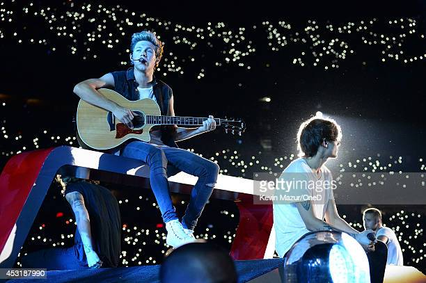 Niall Horan and Louis Tomlinson of One Direction perform onstage during the Where We Are tour at Met Life Stadium on August 4 2014 in New York City