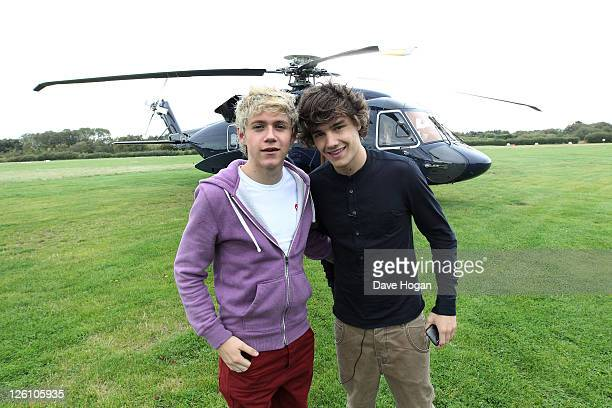 LR Niall Horan and Louis Tomlinson of One Direction travel in a luxury helicopter to Glasgow Manchester and London on September 11 2011 The tour was...