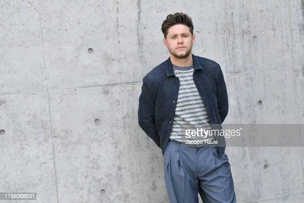 Niall Horan attends the Emporio Armani fashion show during the Milan Men's Fashion Week Spring/Summer 2020 on June 15 2019 in Milan Italy