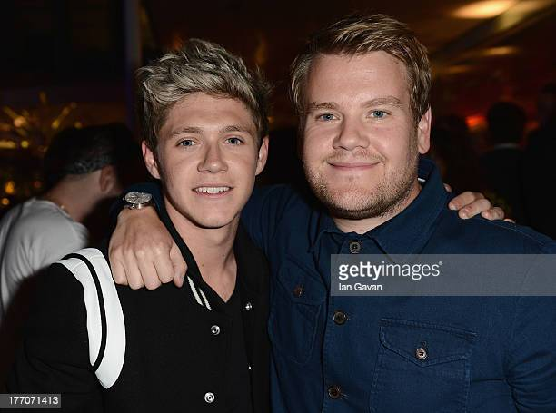 Niall Horan from One Direction and James Corden attend the One Direction This Is Us world premiere after party on August 20 2013 in London England