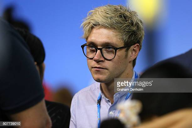Niall Horan from the band One Direction watches the Men's Singles Final match between Andy Murray of Great Britain and Novak Djokovic of Serbia...