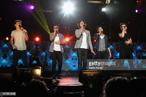 Niall Horan Harry Styles Liam Payne Zayn Malik and Louis Tomlinson of One Direction performs onstage during Z100's Jingle Ball 2012 presented by...