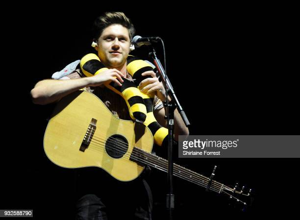 ONLY ** Niall Horan holds a Manchester Bee soft toy given by a fan as he talks about the strength and solidarity of Manchester following the arena...