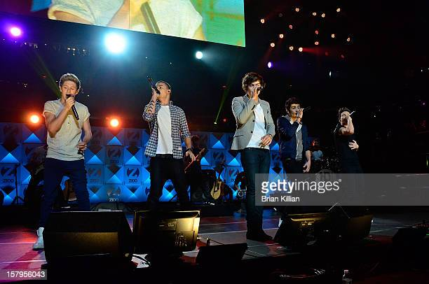 Niall Horan Liam Payne Harry Styles Zayn Malik and Louis Tomlinson of the group One Direction perform onstage during Z100's Jingle Ball 2012...