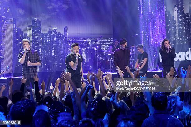 Niall Horan Liam Payne Louis Tomlinson and Harry Styles of One Direction perform onstage at Dick Clark's New Year's Rockin' Eve with Ryan Seacrest...
