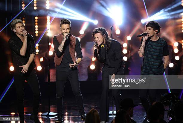 Niall Horan Liam Payne Louis Tomlinson and Harry Styles of the band One Direction perform onstage at the 2015 American Music Awards at Microsoft...