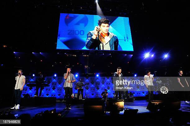 Niall Horan Liam Payne Zayn Malik Harry Styles and Louis Tomlinson of tyhe group One Direction perform onstage during Z100's Jingle Ball 2012...