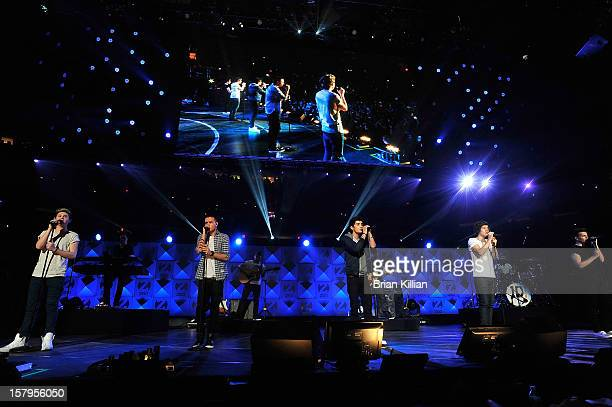 Niall Horan Liam Payne Zayn Malik Harry Styles and Louis Tomlinson of the group One Direction perform onstage during Z100's Jingle Ball 2012...