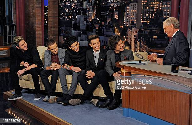 Niall Horan Liam Payne Zayn Malik Louis Tomlinson and Harry Styles members of pop supergroup One Direction talk with David Letterman when they make...