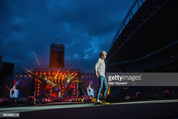 Niall Horan of One Direction performs on stage at CenturyLink Field on July 15 2015 in Seattle Washington