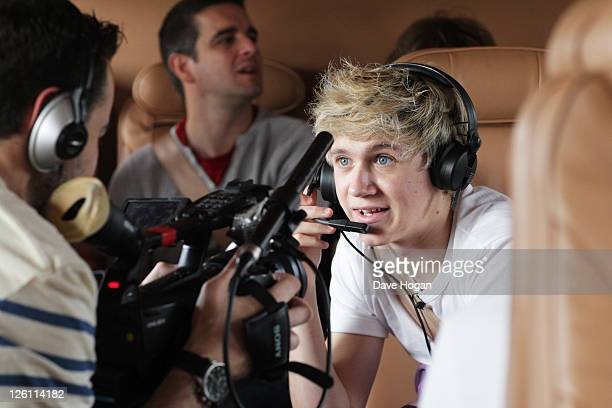 Niall Horan of One Direction travels in a luxury helicopter to Glasgow Manchester and London on September 11 2011 The tour was taken in a luxury...