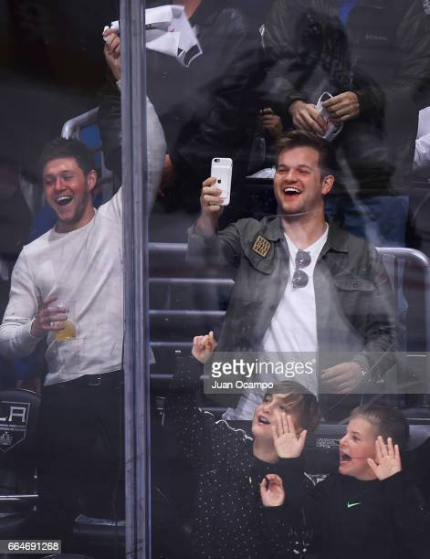 Niall Horan of One Direction watches the game between the Los Angeles Kings and the Edmonton Oilers on April 4 2017 at Staples Center in Los Angeles...