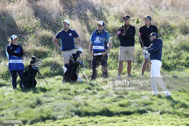 Niall Horan of Team Europe plays a shot as Jamie Dornan of Team Europe looks on during the celebrity challenge match ahead of the 2018 Ryder Cup at...