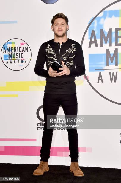 Niall Horan poses in the press room during the 2017 American Music Awards at Microsoft Theater on November 19 2017 in Los Angeles California