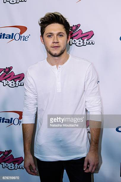 Niall Horan poses on the red carpet at TD Banknorth Garden on December 11 2016 in Boston Massachusetts