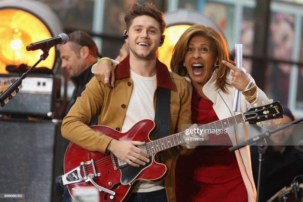 Niall Horan shares a laugh with 'Today' Show host Hoda Kobt when he performs on NBC's 'Today' Show at Rockefeller Plaza on October 26, 2017 in New York City.