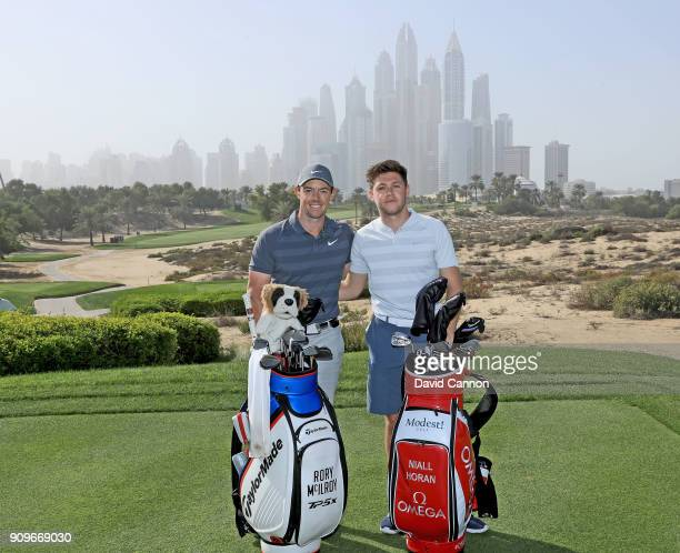 Niall Horan the musical artist poses for a picture on the eighth tee with Rory McIlroy of Northern Ireland during the pro-am as a preview for the...