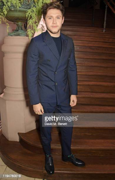 Niall Horan wearing Paul Smith attends an intimate dinner in celebration of 50 years of Paul Smith at Le Trianon on January 19 2020 in Paris France