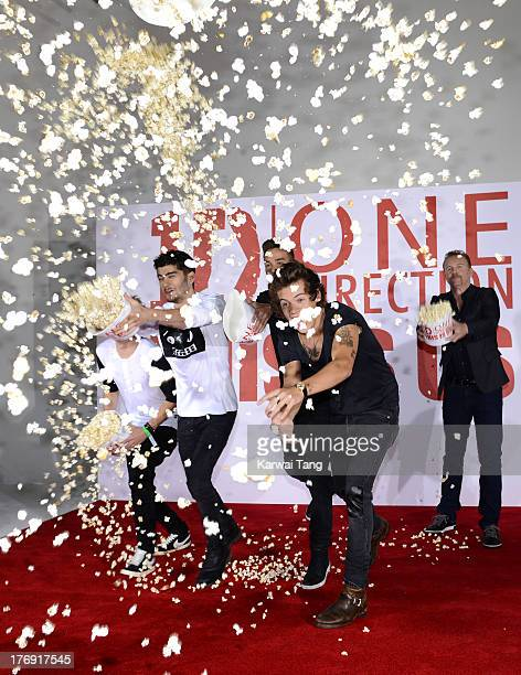 Niall Horan, Zayn Malik, Liam Payne and Harry Styles of One Direction with Morgan Spurlock attend a photocall to launch their new film 'One...