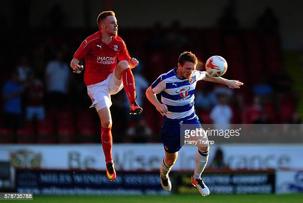 Niall Keown of Reading challenges for the high ball with James Brophy of Swindon Town during the Pre Season Friendly match between Swindon Town and...
