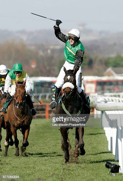 Niall Madden on Irish mount Numbersixvalerde celebrates after winning the 2006 Grand National steeplechase during the Grand National meeting at...