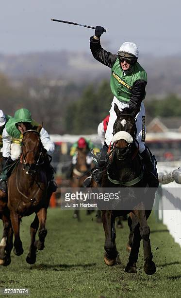 Niall Madden shows his delight as Numbersixvalverde lands The John Smiths' Grand National Steeple Chase Race run at Aintree on April 8 in Aintree...