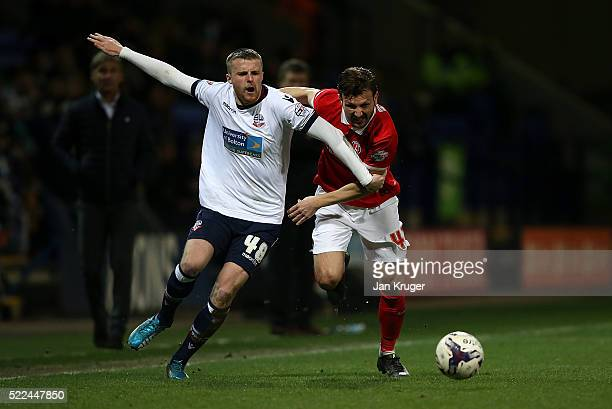 Niall Maher of Bolton Wanderers battles with Marco Motta of Charlton Athletic during the Sky Bet Championship match between Bolton Wanderers and...