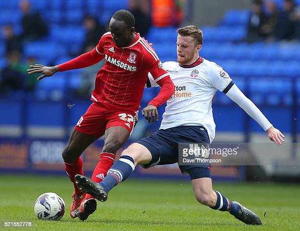 Niall Maher of Bolton Wanderers tackles Albert Adomah of Middlesbrough during the Sky Bet Championship match between Bolton Wanderers and...