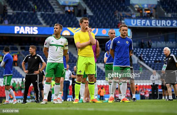 Niall McGinn, Michael McGovern and Lee Hodson of Northern Ireland show their dejection after the UEFA EURO 2016 round of 16 match between Wales and...