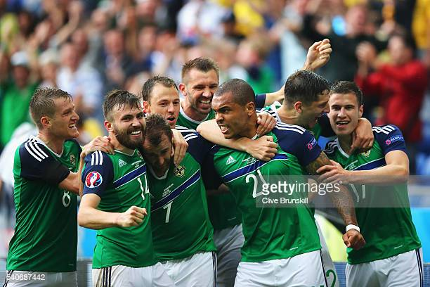 Niall McGinn of Northern Ireland celebrates scoring his team's second goal with his team mates during the UEFA EURO 2016 Group C match between...