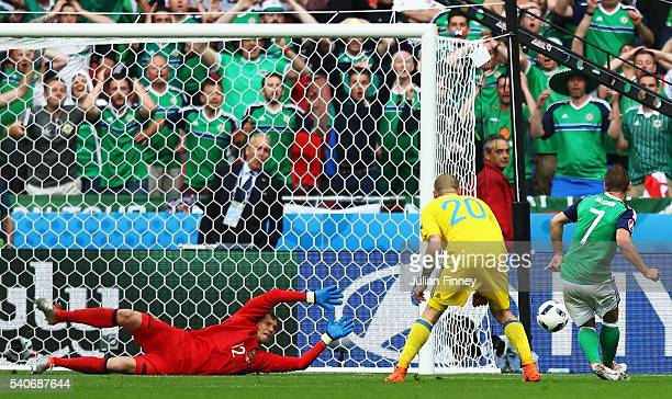 Niall McGinn of Northern Ireland scores his team's first goal past Andriy Pyatov of Ukraine during the UEFA EURO 2016 Group C match between Ukraine...