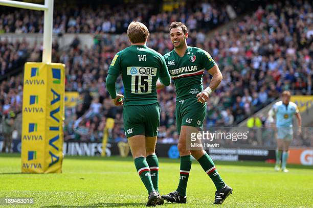 Niall Morris of Leicester is congratulated by teammate Mathew Tait after scoring the opening try during the Aviva Premiership Final between Leicester...