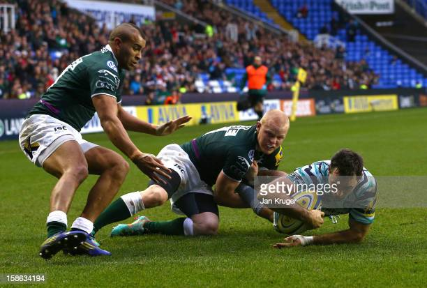 Niall Morris of Leicester Tigers holds off Tom Homer and Jonathan Joseph of London Irish to score the opening try during the Aviva Premiership match...