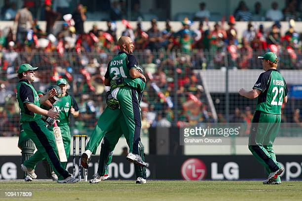 Niall O'Brien and Andre Botha of Ireland celebrates the dimissal of Tamim Iqbal of Bangladesh caught by William Porterfield of the bowling of Andre...