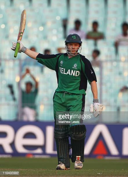 Niall O'Brien of Ireland celebrates his half century during the 2011 ICC World Cup match between Ireland and Netherlands at Eden Gardens on March 18...